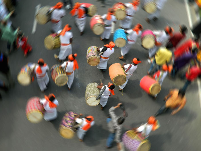 High angle view of men with drums walking on street