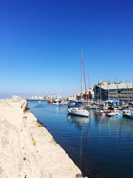 EyeEm Selects Tel Aviv Jaffa Port Nautical Vessel Water Mode Of Transport Copy Space Clear Sky Blue Moored Transportation Sea No People Outdoors Day Nature Harbor Sailboat Mast Sunlight Tranquility Scenics Beauty In Nature Transportation Sommergefühle