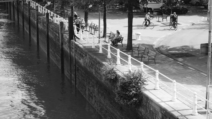 Embankment in Antwerp Embankment Stone Wall Square City Life Cityscape EyeEm Best Shots - Black + White Black And White Blackandwhite Monochrome Embankment Railing Waterfront Water Antwerp Belgium Water Day High Angle View Incidental People Street City Architecture Built Structure Reflection Real People Building Exterior Transportation Sunlight Barrier Boundary Outdoors