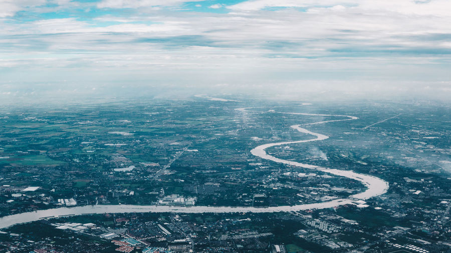 Cityscape River Clouds And Sky From An Airplane Window Water Backgrounds Aerial View Sky Horizon Over Water Calm Urban Scene