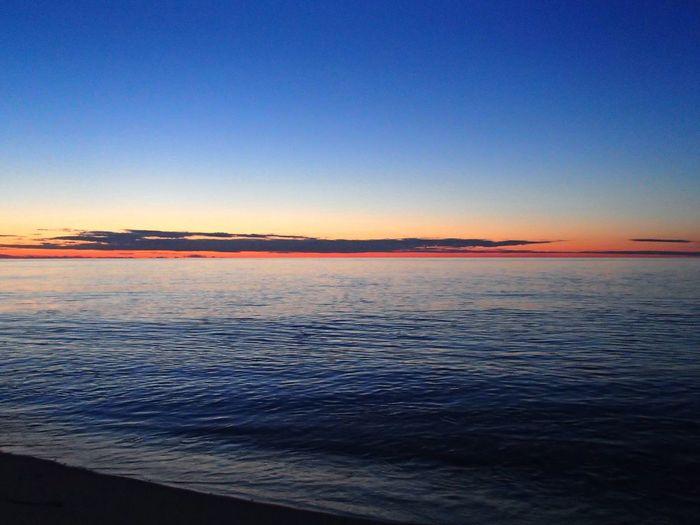 Sunset over Atlantic Ocean EyeEmNewHere Cape Cod Sky Water Sea Scenics - Nature Beauty In Nature Beach Tranquil Scene Sunset Idyllic Horizon Over Water