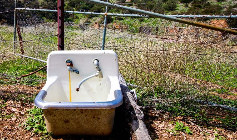 Don't forget to wash EyeEmNewHere Bathroom Nature Sink Day Sunlight No People Plant Faucet Metal Abandoned Fence Growth Outdoors Grass