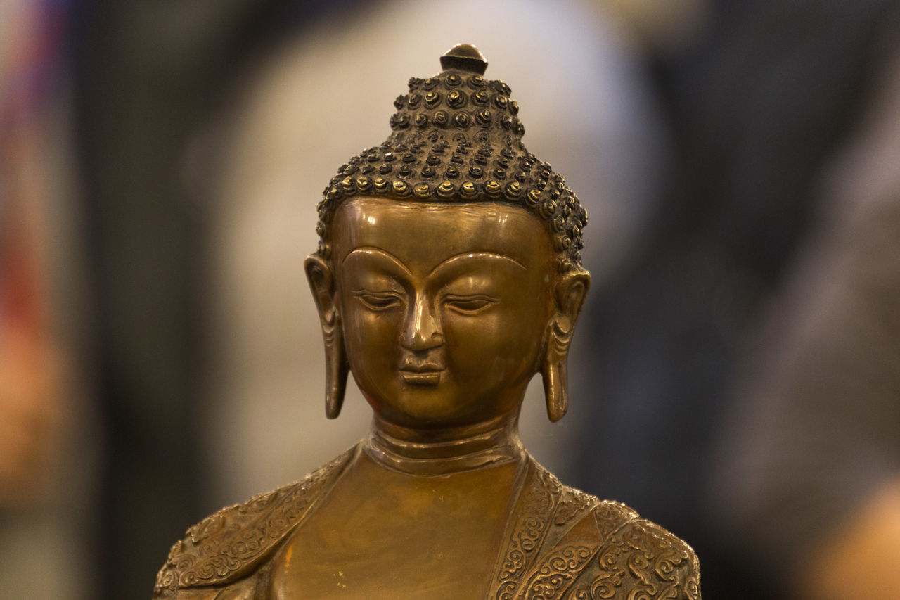 statue, human representation, male likeness, sculpture, gold colored, art and craft, focus on foreground, religion, spirituality, idol, gold, close-up, no people, indoors, day