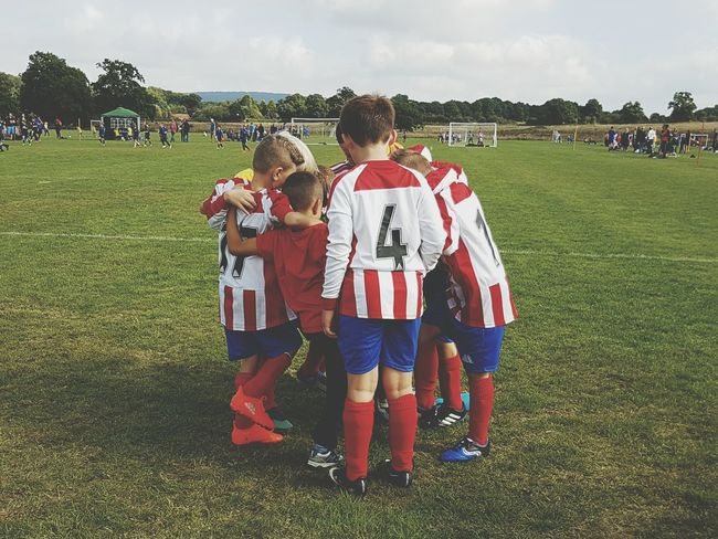 Full Length People Sports Team Unity Outdoors Soccer Dedication Soccer Uniform Sports Uniform Soccer Player Togetherness Sky Day Team Team Huddle Winners My Sons Team