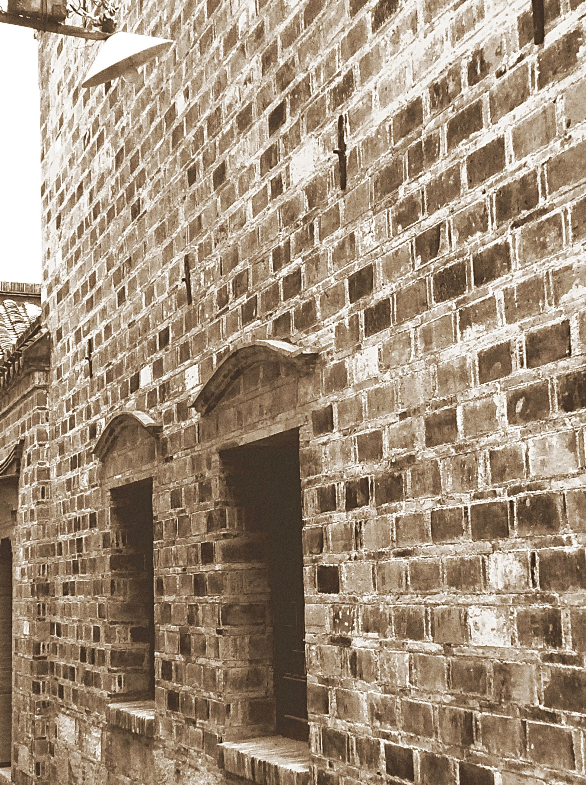 architecture, built structure, building exterior, brick wall, wall - building feature, stone wall, old, wall, history, weathered, brick, low angle view, window, pattern, building, outdoors, text, day, textured, damaged