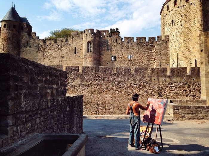 Peintre du dimanche Architecture Built Structure Building Exterior Men History Stone Wall Full Length Sky Travel Destinations Tourist Fortified Wall Cloud - Sky Tourism The Past Famous Place Person Fort Togetherness Day Medieval Carcassonne City Painter