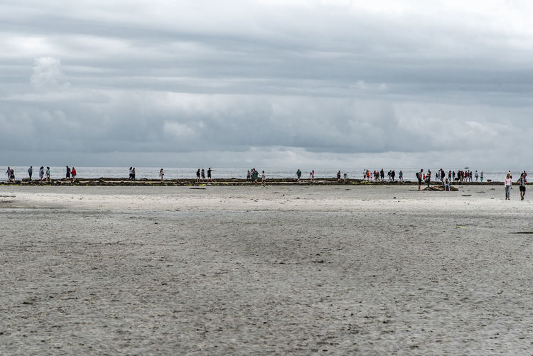 People can walk to St Michael's Mount on low tide - and they do! Walking Around Beach Cloud - Sky Crowd Dam Day Group Of People Land Leisure Activity Low Tide Men Nature Outdoors Sand Sea Water Women
