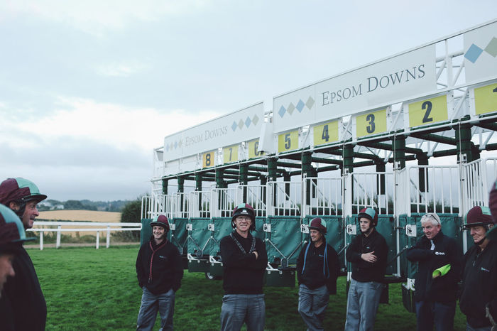 Building Exterior Casual Clothing City City Life Day Epsom Downs Racecourse Gate Gates Horse Horse Racing Horse Riding Jockey Jockeys Large Group Of People Leisure Activity Lifestyles Men Outdoors Person Race Race Course Riding Sky Standing Start