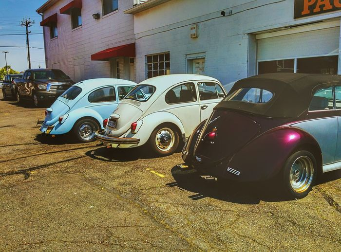 Old Car Volkswagen Bug Parking Sunny Street