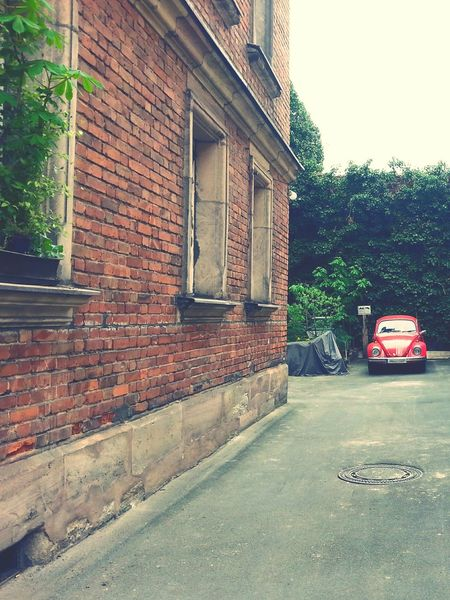 red car 🚗 Architecture Building Exterior Built Structure Protection Day Outdoors Tree No People Sky Red Color Car Beatle Red Car Vw Bug EyeEmNewHere Idyllic Scenery Backyard Photography Accent Color Focus On Background Car Photography Oldtimer Urbanphotography Urban Photography Urban Exploration The Secret Spaces The Street Photographer - 2017 EyeEm Awards BYOPaper! Mobility In Mega Cities Stories From The City