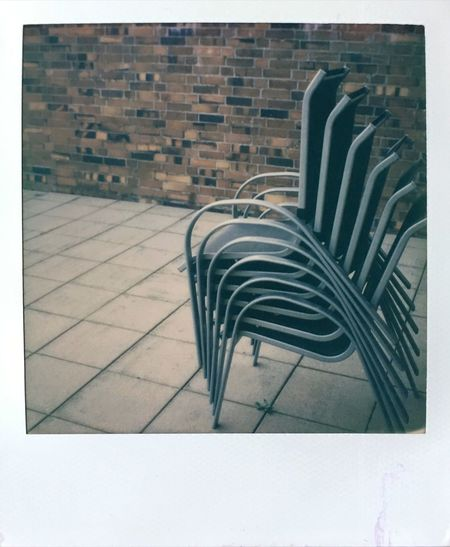 It's getting cold outside... Terrace Chair No People Brick Wall Autumn Stack of Chairs Stacking Chairs Film Photography Polaroid Slr680 Impossible Project Instantphotography Buyfilmnotmegapixels Empty Places
