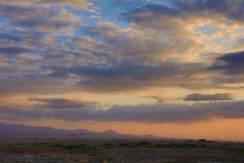 sunset in Amboseli NP, Kenya Africa African Rift Valley Amboseli National Park Atmosphere Atmospheric Mood Cloudscape Dramatic Sky Landscape Mountain Range National Parks Kenya Orange Color Rift Valley Sunset Tranquility
