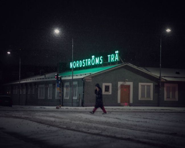 Walking home. Stockholm in the snow December Winter Night Illuminated Architecture Building Exterior Street Text Built Structure Road Transportation City Sign