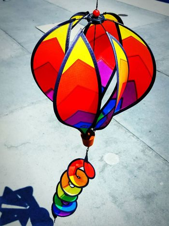 Spinning In The Wind Windsock Colorful Outdoors Spinning In Circles Sidewalk Fine Art Perspective Things You See ForTheLoveOfPhotography Multi Colored Eyeemphotography Eye4photography  Photography Is My Therapy Bright Colors From My Point Of View EyeEm
