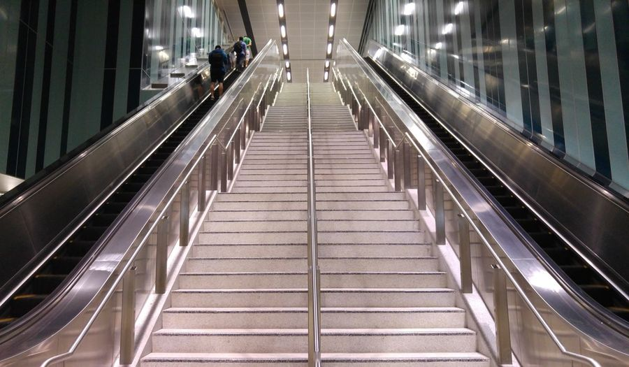 Low Angle View Of Escalator Subway Station