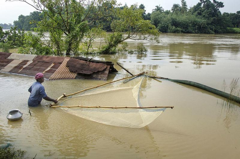 Man Fishing In River