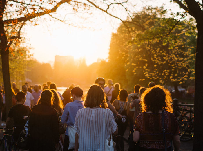 People standing at public park during sunset