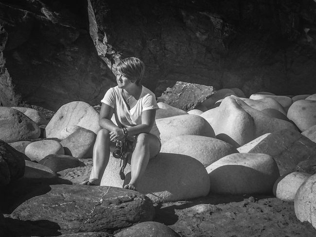 A moments thoughts Deep In Thought About Returning To My Photography Passion EyeEm Ready   Beach Nature Real People Thinking Sitting Portrait One Step Forward Outdoors Coastal Life Photographer Rock Formation Front View Lifestyles One Person Young Women Rock - Object Large Rocks Woman Thinking About Her Next Photograph The Lizard Cornwall