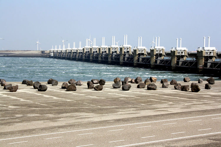 Flock Of Pier On Sea Against Clear Sky