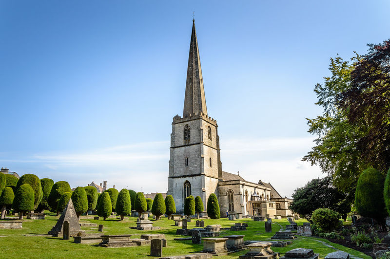 Low Angle View Of St Mary Church With Cemetery In Foreground At Painswick