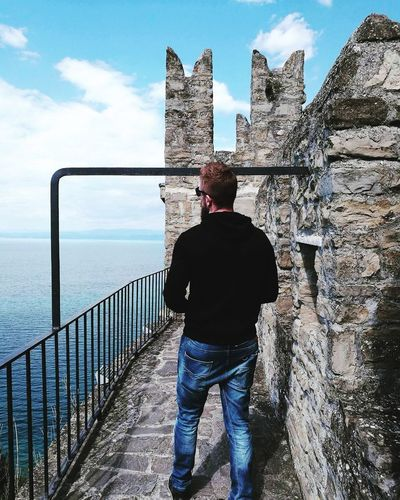 One Man Only Casual Clothing One Person Adult Outdoors People Cloud - Sky Standing Day Rear View Men Sea Nature Water Rocks Stone Slovenia Sky And Clouds Sea And Sky Urban Skyline Castle Piran Travel Destinations Blue Sky