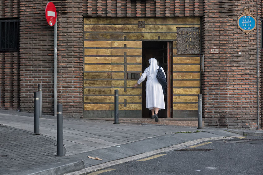 Nun entering her convent Bilbao Brick Wall Building Exterior Convent Full Length Nun One Person Outdoors Portrait SPAIN Standing