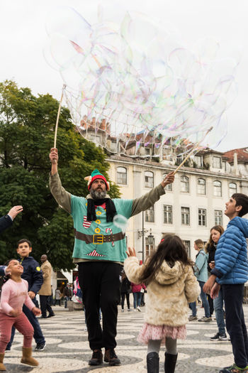 Bubbles Children Fun Adult People Smiling Men Day Outdoors City