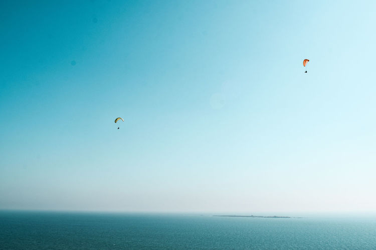 Mediterranean sea, 2 paragliders and an island Paragliders Two People Island Tabarca Island High Above Sport Leisure Activity Mediterranean Sea Turquoise Colored Orange Color In The Sky Flying Paragliding Water Clear Sky Parachute Mid-air Blue Shore Wave Horizon Over Water Calm Ocean Seascape