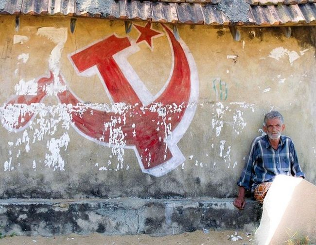 Indian old guy in Kerala, India near kommunists paint Kerala India Old Man Grany Comunism One Person Graffiti Front View Lifestyles Wall - Building Feature Real People Architecture My Best Travel Photo