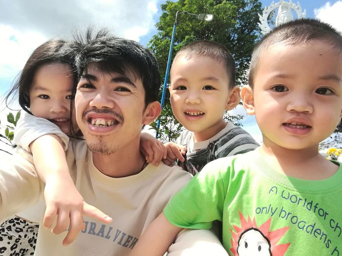 Portrait of smiling father with children