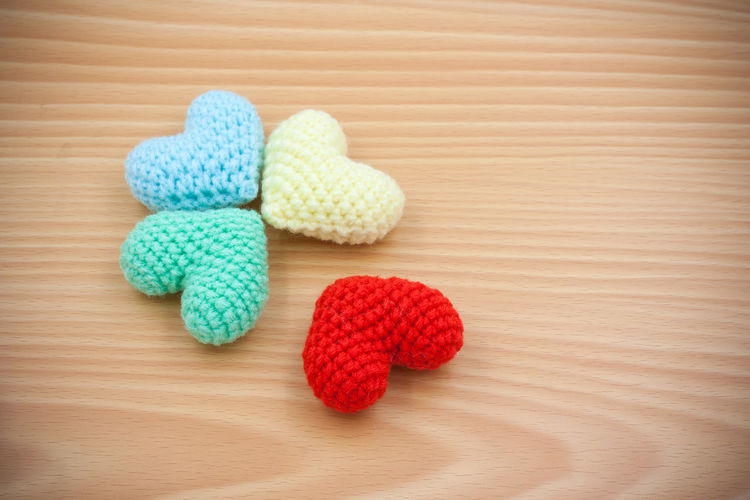 Close-up of multi colored heart shape on wooden table