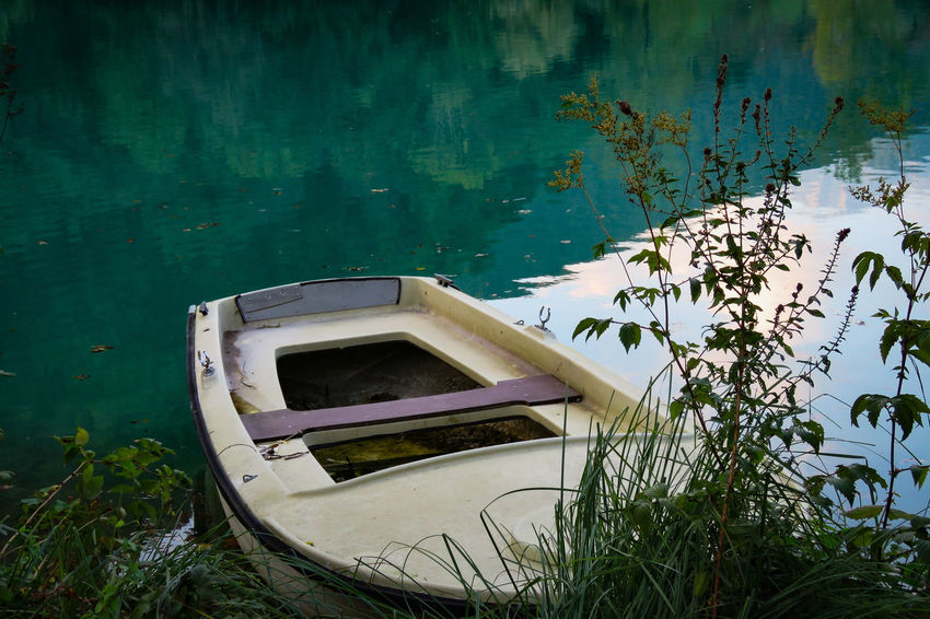I feel sLOVEnia. ♥️ Vessel Old Boat Vacations Best  Reflection Water No People Slovenia Most Na Soci EyeEm Best Shots EyeEm Gallery EyeEm Selects Beautiful Day Sunshine Day Nature Green Water Soca River EyeEm Best Shots - Nature Daylight Water Nautical Vessel Lake High Angle View Boat Moored Water Vehicle
