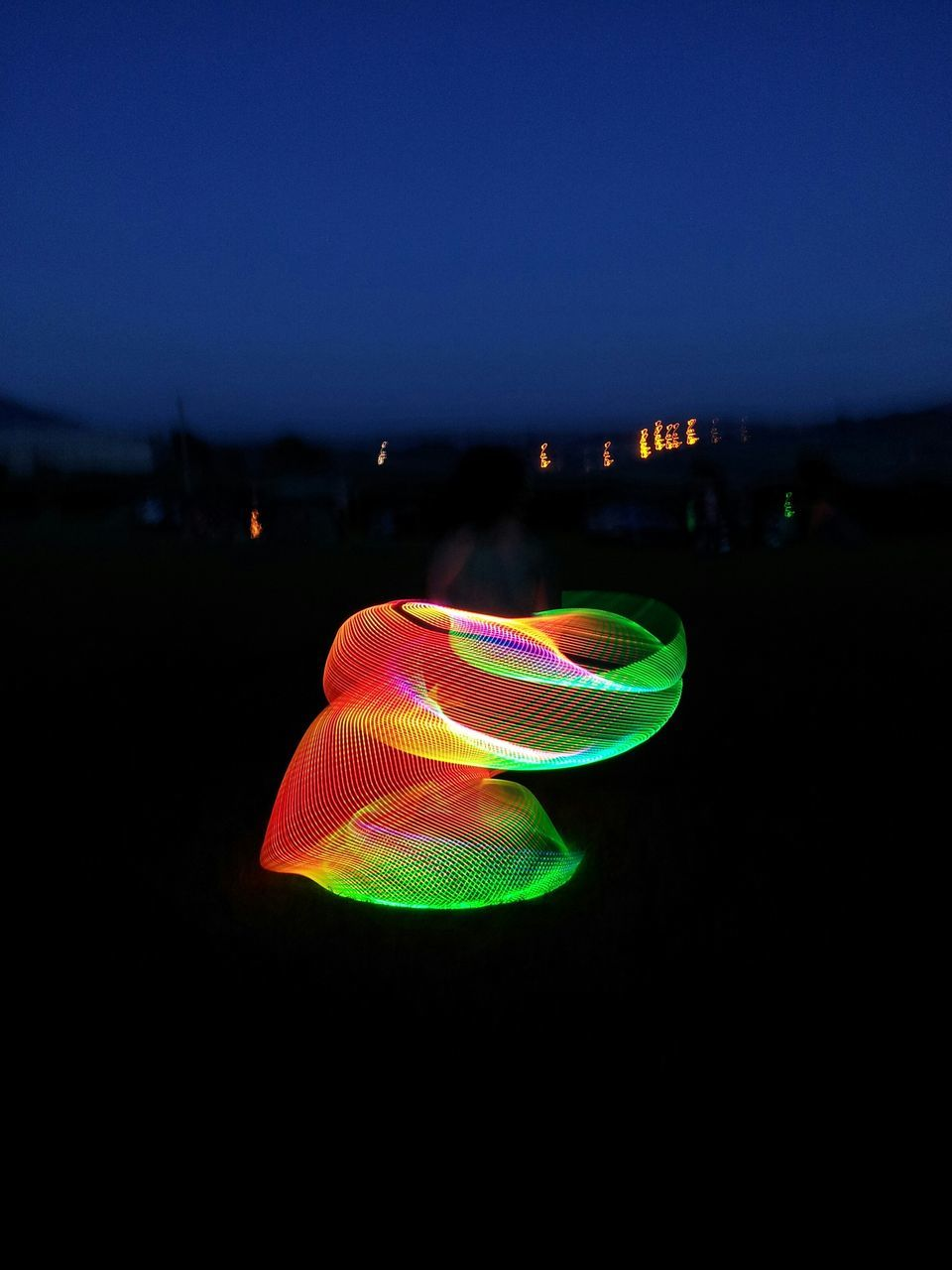Low Angle View Of Light Painting Against Sky At Dusk