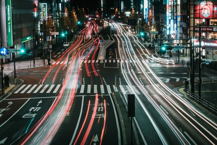 City Illuminated Street Transportation Road Night Architecture Motion Mode Of Transportation Light Trail High Angle View City Street Building Exterior Long Exposure Built Structure Traffic City Life Speed Sign Motor Vehicle
