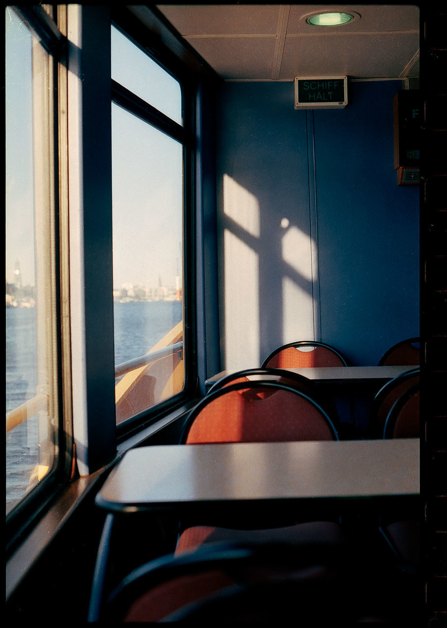 VIEW OF TRAIN WINDOW IN EMPTY BUS