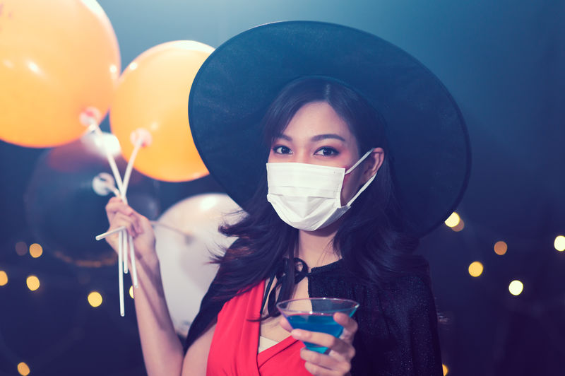 Portrait of young woman drinking balloons