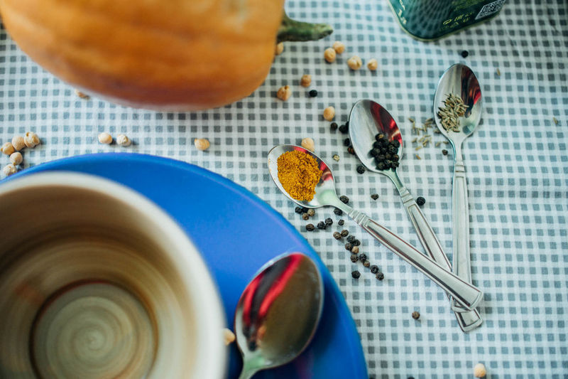 High angle view of spices with pumpkin on table