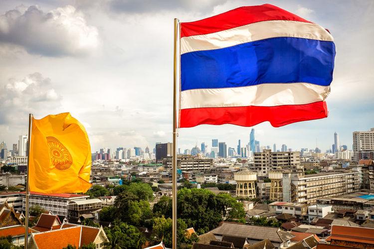Bangkok Bangkok Thailand. Flags In The Wind  Thai Flag View Over Bangkok View Over Bangkok With Flags
