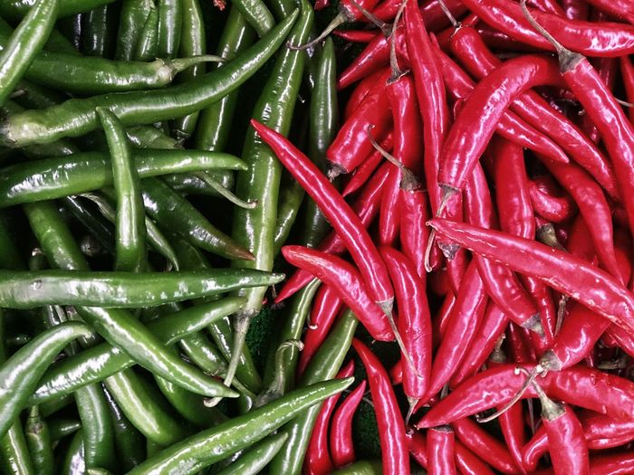 Full Frame Shot Of Green And Red Chilies
