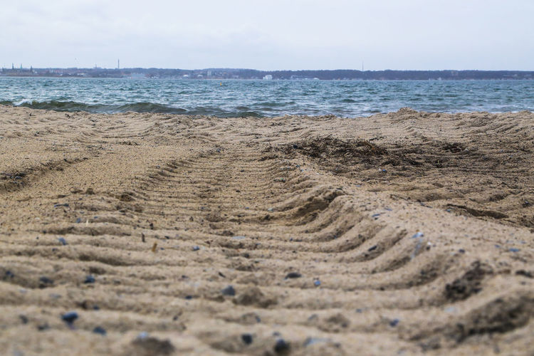 Surface level of tire tracks on beach