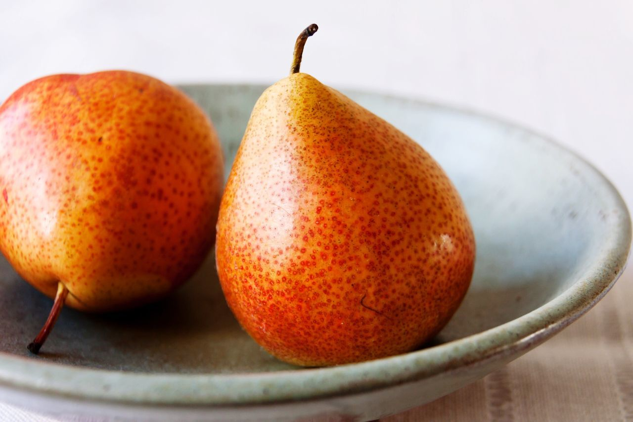 Close-up of pear in plate