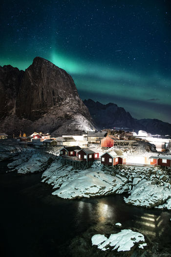 Northern lights over the fishing huts of lofoten islands, norway.
