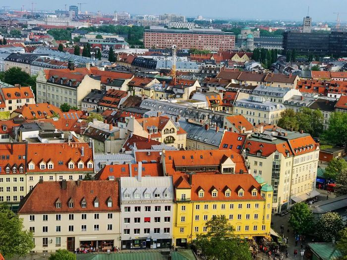 Old Town Marienplatz Red Roofs Building Exterior Architecture Built Structure City Building Residential District Crowd Cityscape Crowded High Angle View Day Outdoors House Nature Town Religion Travel Destinations Roof Place Of Worship TOWNSCAPE