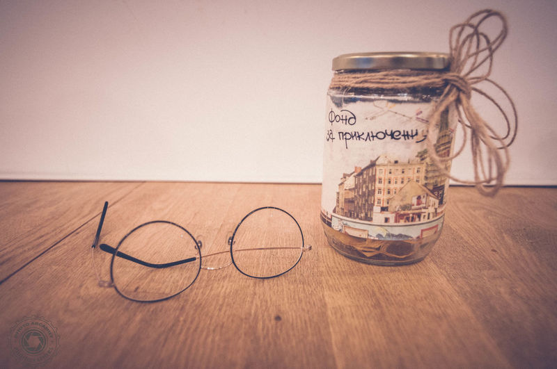 Finance Indoors  Close-up Piggy Bank Adventure Money For Rainy Days Glasses