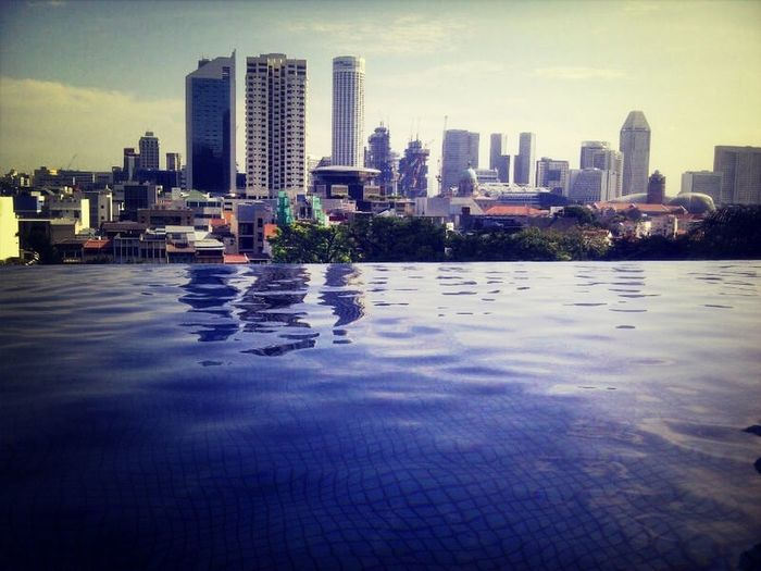 Infinity pool • City View  • Relaxing • Singapore Parkroyalhotel ExploreSingapore Explore The World Designs PhonePhotography Shadesandshadows Architecture Photography Reflections And Shadows Reflection In The Water Clear Sky