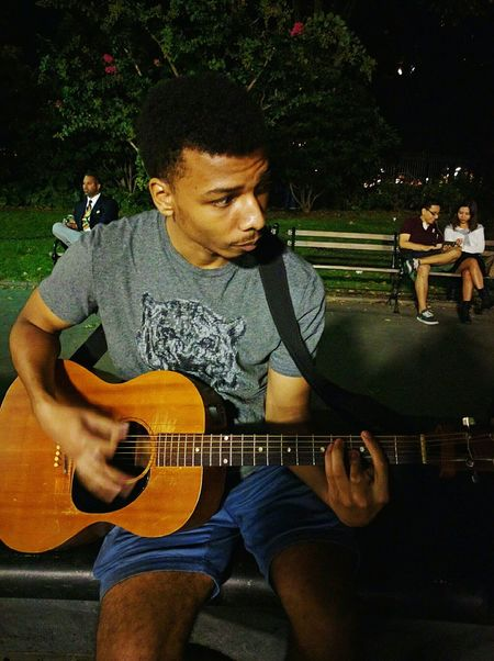 Wow my last post was a year ago o.o I'm back :) not my pic but my friend took this of our dear friend here is a Boy in brooklyn Guitar Man Brooklyn Washington Square Park Lifestyles Hanging Out Having Fun Summer Mixed Race Person Lifestyles