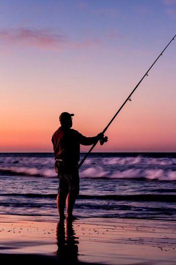 Fisherman's Blues Fishing Sea One Person Silhouette Outdoors Beach Scenics Coastline Coastline Landscape California Coast Beachphotography Coast Beach Life Beach Photography Travel Coastal Life Beachlife Sunrise Sunrise_Collection Sunrise Silhouette Fisherman