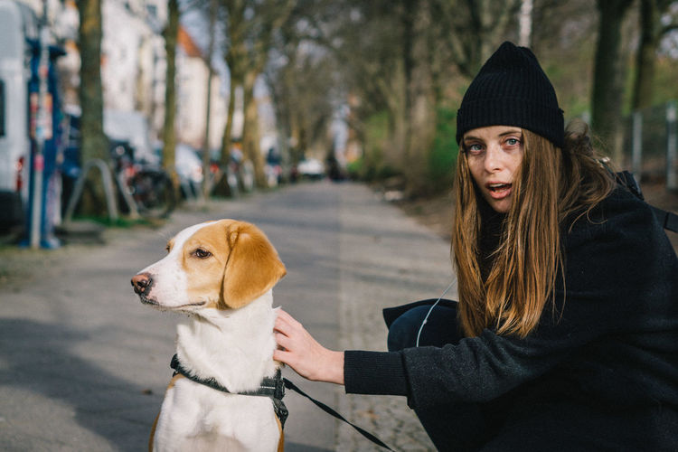 Portrait of woman with dog in winter