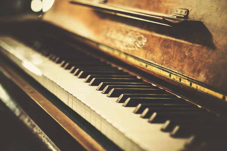 Vintage classic piano with ebony and ivory black and white keys. Antique Classic Gold Retro Aged Art Arts Culture And Entertainment Classical Music Close-up Day Hipster Indoors  Instrument Keyboard Music Musical Musical Instrument Musician Old Old Instruments Piano Piano Key Selective Focus Vintage Wood - Material