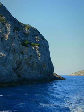 Rock Formation Cliff On A Boat Steep Cliff Sea Water Greek Islands Transportation Blue Nature Beauty In Nature Rocky Cape  Island Islets Rock Share Your Adventure Landscapes Seascape On A Ship Aegean Sea Cliffs Rocks Rocks And Water